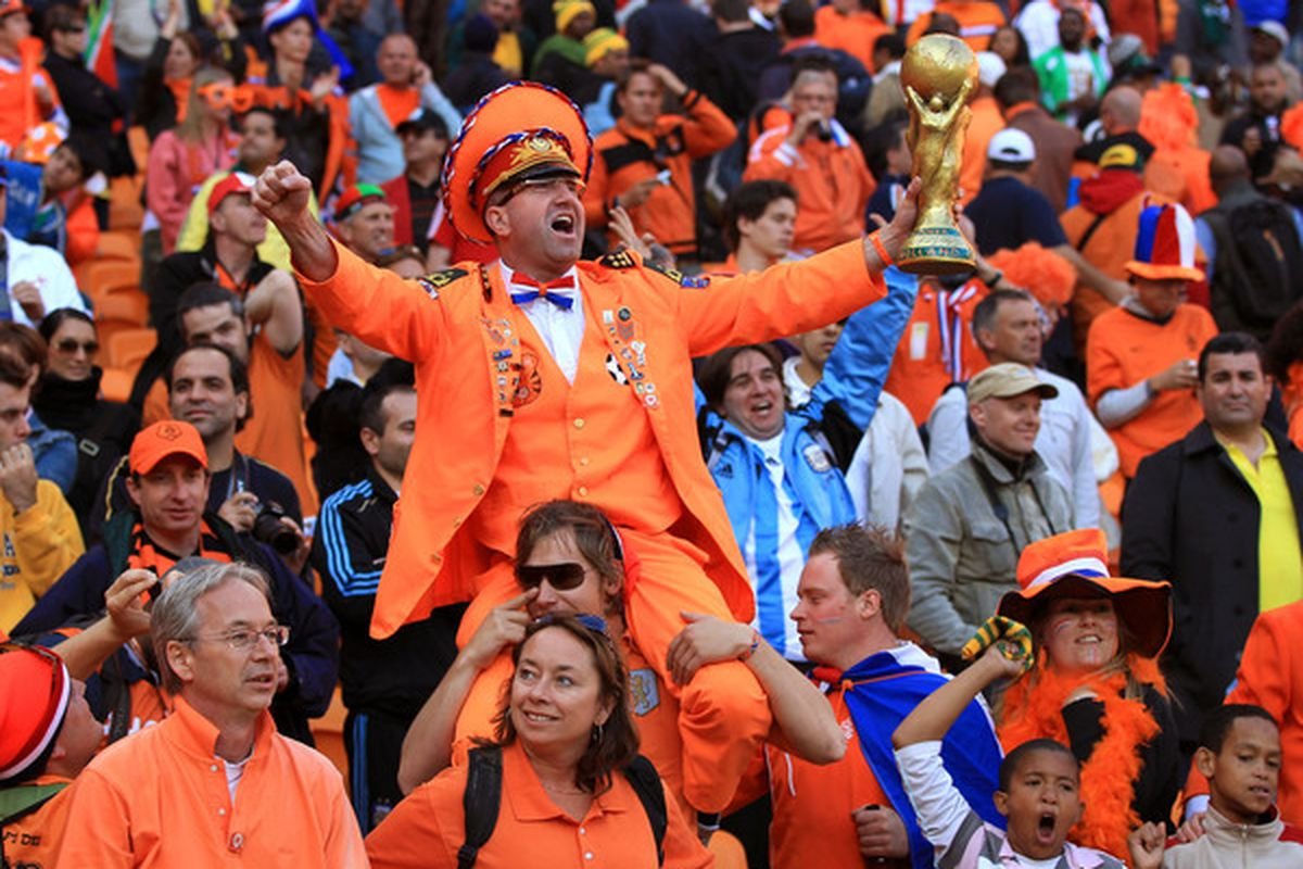 JOHANNESBURG, SOUTH AFRICA - JUNE 14:  Dutch fans celebrate during the 2010 FIFA World Cup Group E match between Netherlands and Denmark at Soccer City Stadium on June 14, 2010 in Johannesburg, South Africa.  (Photo by David Cannon/Getty Images)