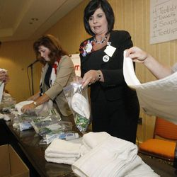 Heather Sandstrom, a delegate from Arizona, center, helps Utah delegates with assembling humanitarian kits in Tampa, Fla.  The Republican National Convention was put on hold because of Hurricane Isaac but the Utah delegates used their extra time to put together humanitarian kits on Monday.  Delegates from Hawaii and Arizona helped out with the 1,000 sanitary kits and 100 back-to-school kits.  Monday, Aug. 27, 2012