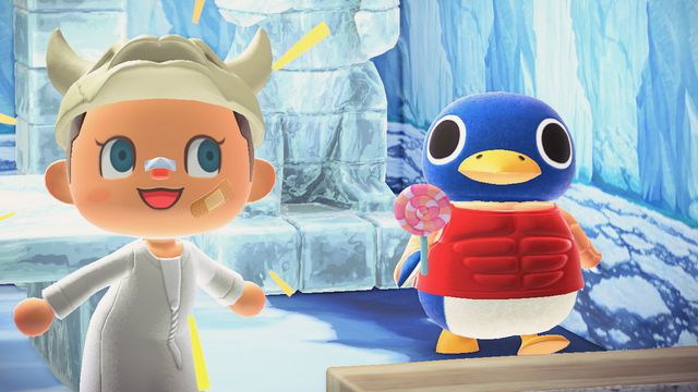 An Animal Crossing player poses with Roald the penguin, who is eating a lollipop.