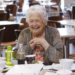Arlene Egbert laughs with friends while eating lunch at Millcreek Senior Center in Salt Lake City Wednesday, May 21, 2014.