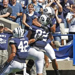 Brigham Young Cougars tight end Kaneakua Friel (82) is congratulated after making a touchdown as Brigham Young University defeats Weber State University in football 45-6 Saturday, Sept. 8, 2012, in Provo, Utah.
