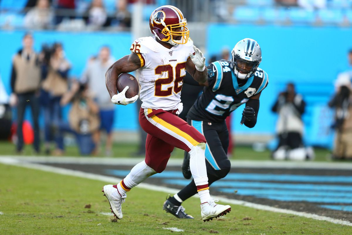 Washington running back Adrian Peterson carries the ball for a touchdown in the fourth quarter against Carolina Panthers cornerback James Bradberry at Bank of America Stadium.