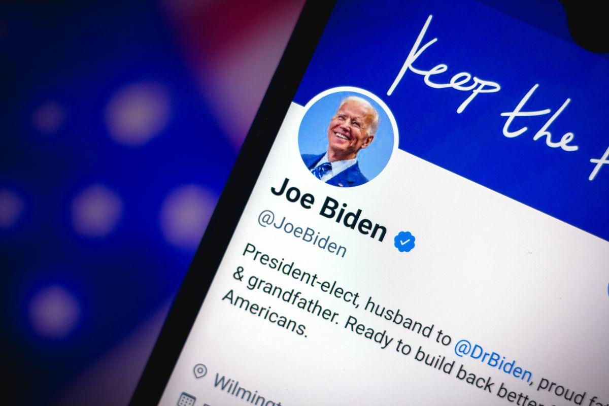 A photo illustration of Joe Biden's Twitter page on a smartphone screen.