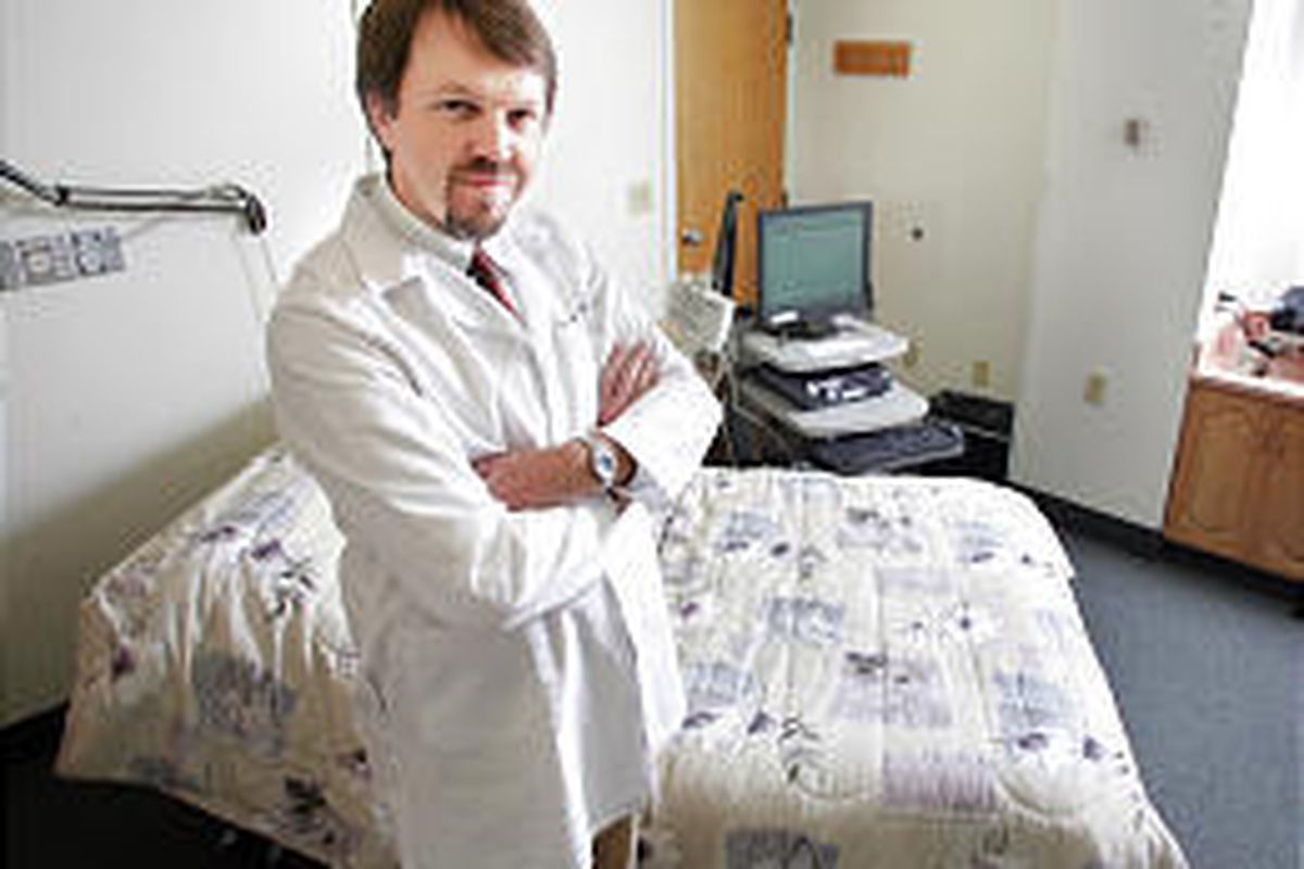 Dr. Tom Cloward, a sleep specialist at the LDS Hospital Sleep Disorders Center, stands in a hospital room that is used for sleep testing.