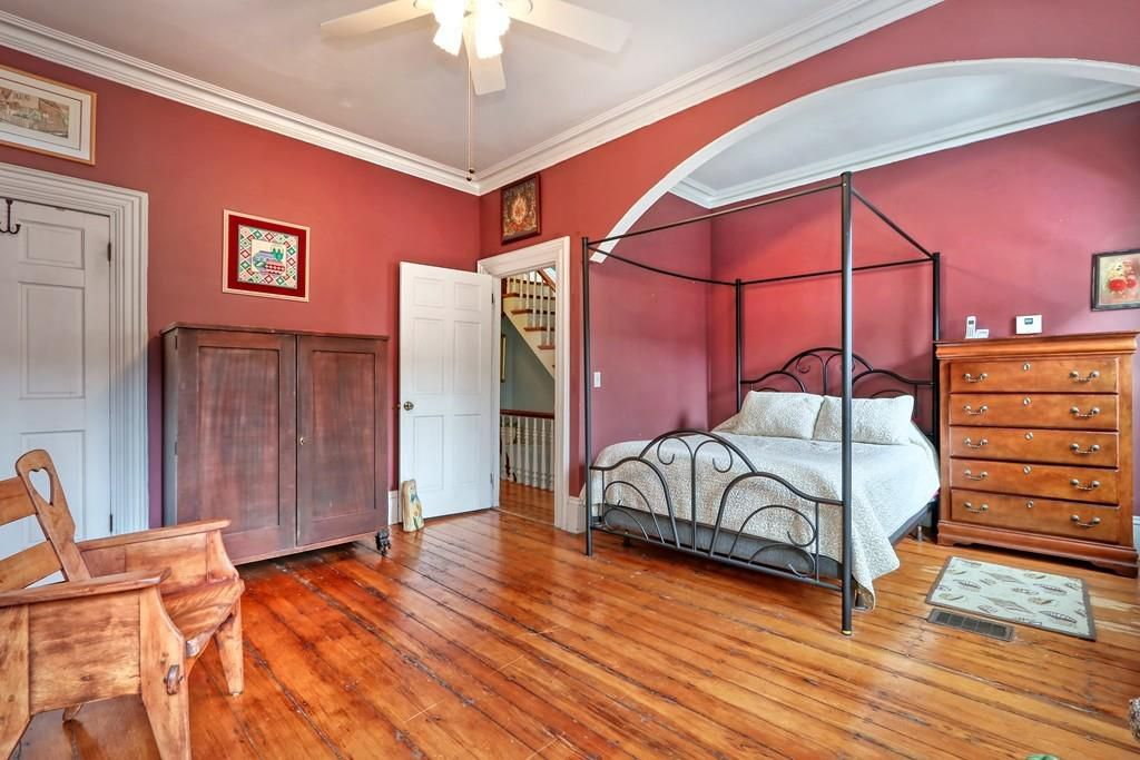 A spacious bedroom with a bed.