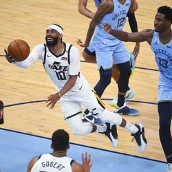 Utah Jazz guard Mike Conley (10) goes to the basket past Memphis Grizzlies forward Jaren Jackson Jr. (13) during the second half of Game 3 of an NBA basketball first-round playoff series Saturday, May 29, 2021, in Memphis, Tenn. Utah won 121-111.