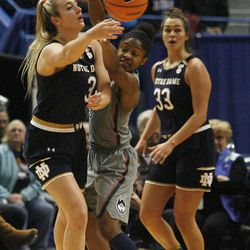 UConn's Crystal Dangerfield (5) tries to prevent Notre Dame's Marina Mabrey (3) from making a pass during the Notre Dame Fighting Irish vs UConn Huskies women's college basketball game in the Women's Jimmy V Classic at the XL Center in Hartford, CT on December 3, 2017.