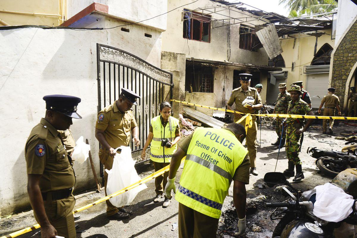 Sri Lankan security personnel and police investigators look through debris outside Zion Church in Batticaloa, a city in the eastern province of Sri Lanka.