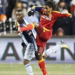 Kansas City's C.J. Sapong and Real's Lovel Palmer battle for the ball as Real Salt Lake and Sporting KC play Saturday, Dec. 7, 2013 in MLS Cup action. Sporting KC won in a shootout.