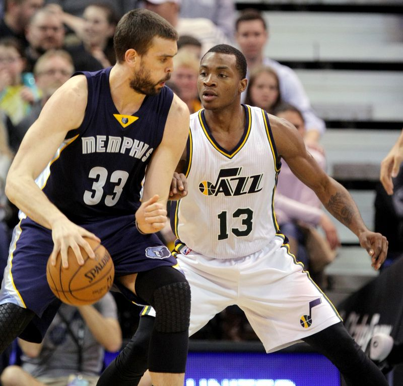 Utah Jazz guard Elijah Millsap (13) does his best to defend Memphis Grizzlies center Marc Gasol (33) as the Jazz and the Grizzlies play Wednesday, Feb. 4, 2015, at EnergySolutions Arena in Salt Lake City. Memphis won 100-90.