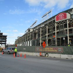 Thu 12/17: Facade previously shrouded, newly finished and primed steel -