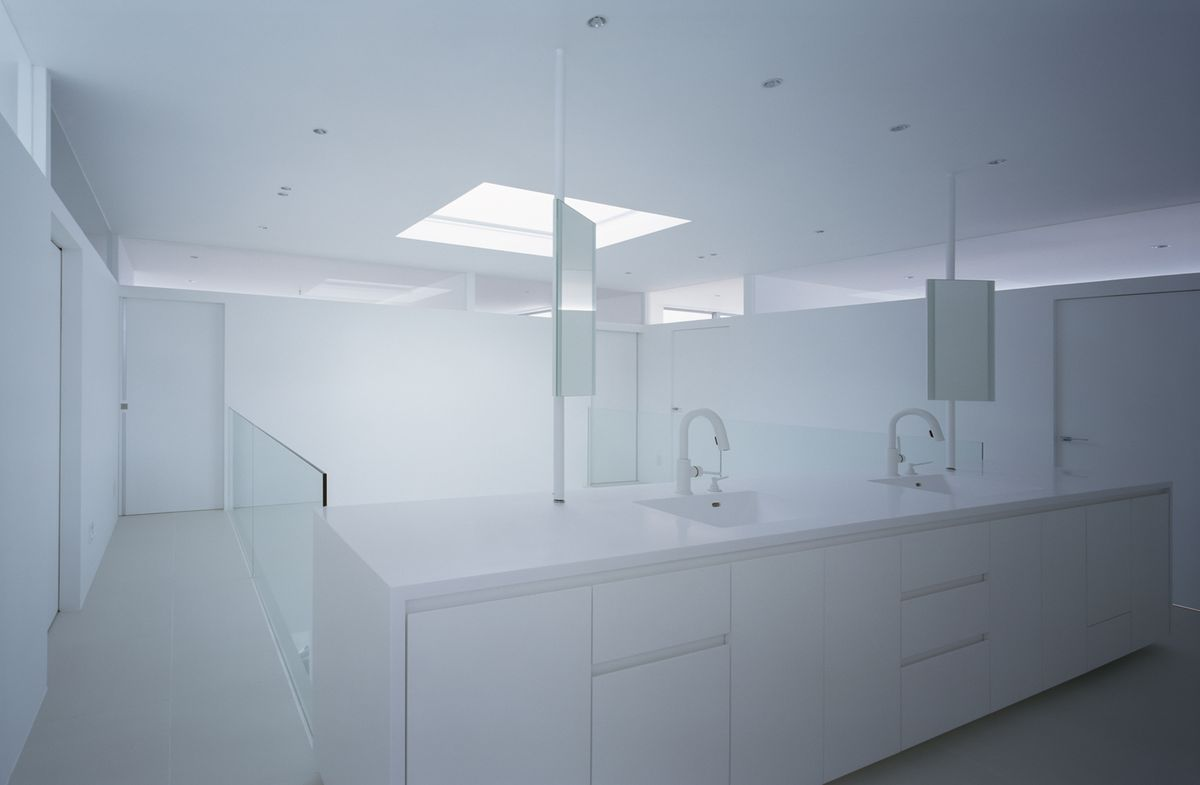 White monochromatic bathroom with double sink.
