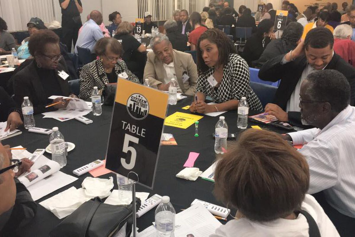 """Attendees at last night's CitizenDetroit School Board Candidate Forum hear from candidates Sonya Mays and Ryan Mack in a """"speed dating round"""" on how they would ensure transparency and robust community engagement if elected. (Courtesy CitizenDetroit)"""