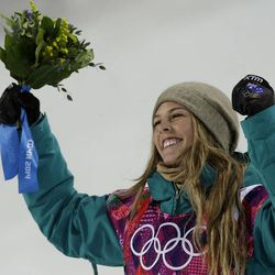 Australia's Torah Bright celebrates after clinching the silver medal in the women's snowboard halfpipe, at the Rosa Khutor Extreme Park, at the 2014 Winter Olympics, Wednesday, Feb. 12, 2014, in Krasnaya Polyana, Russia. (AP Photo/Felipe Dana)