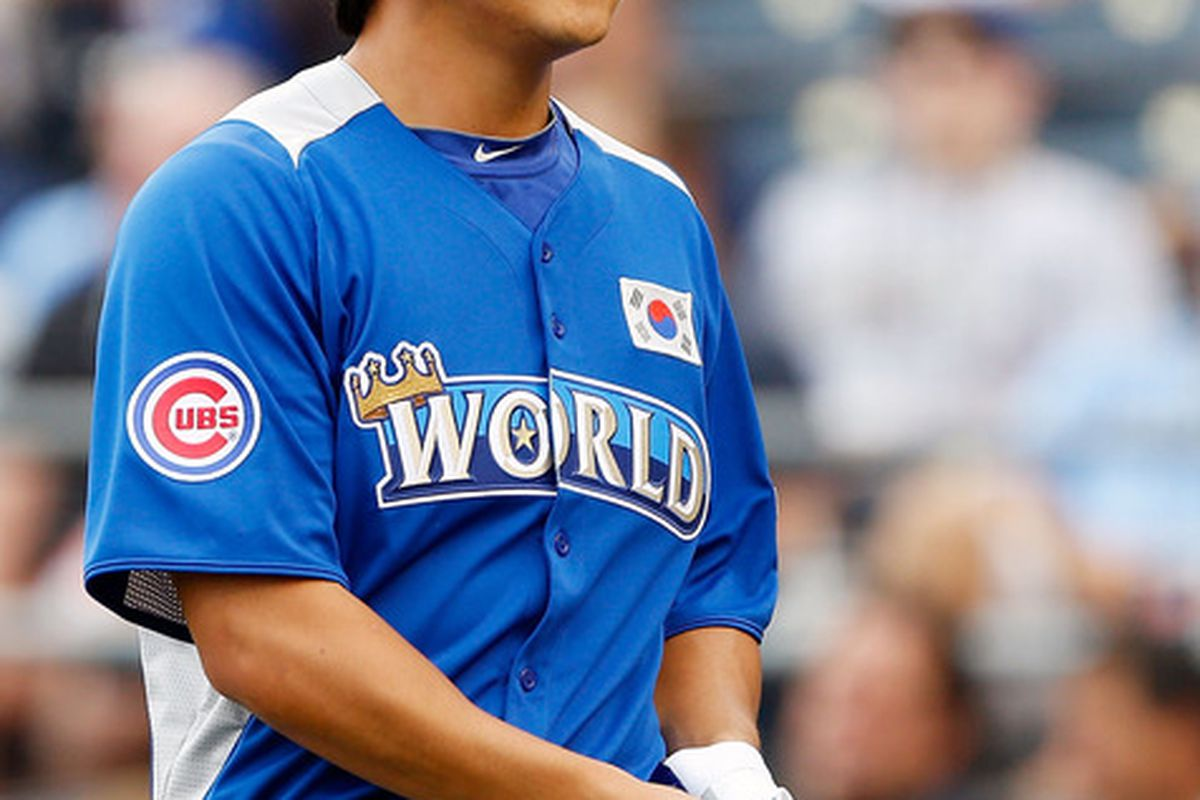 Cubs outfielder Jae-Hoon Ha had a scary collision with a wall tonight.(Photo by Jamie Squire/Getty Images)