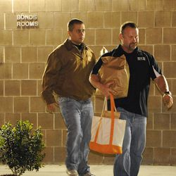 George Zimmerman, left, walks out of the intake building at the John E. Polk Correctional Facility with a bondsman Monday. Zimmerman posted bail on a $150,000 bond on a second degree-murder charge.