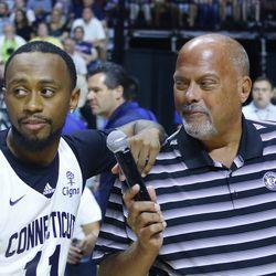 Joe D'Ambrosio interviews Ryan Boatright during a timeout.