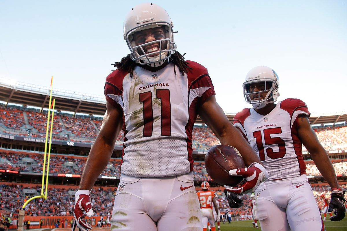Larry Fitzgerald of the Arizona Cardinals celebrates after hauling in a 4th quarter touchdown in Cleveland