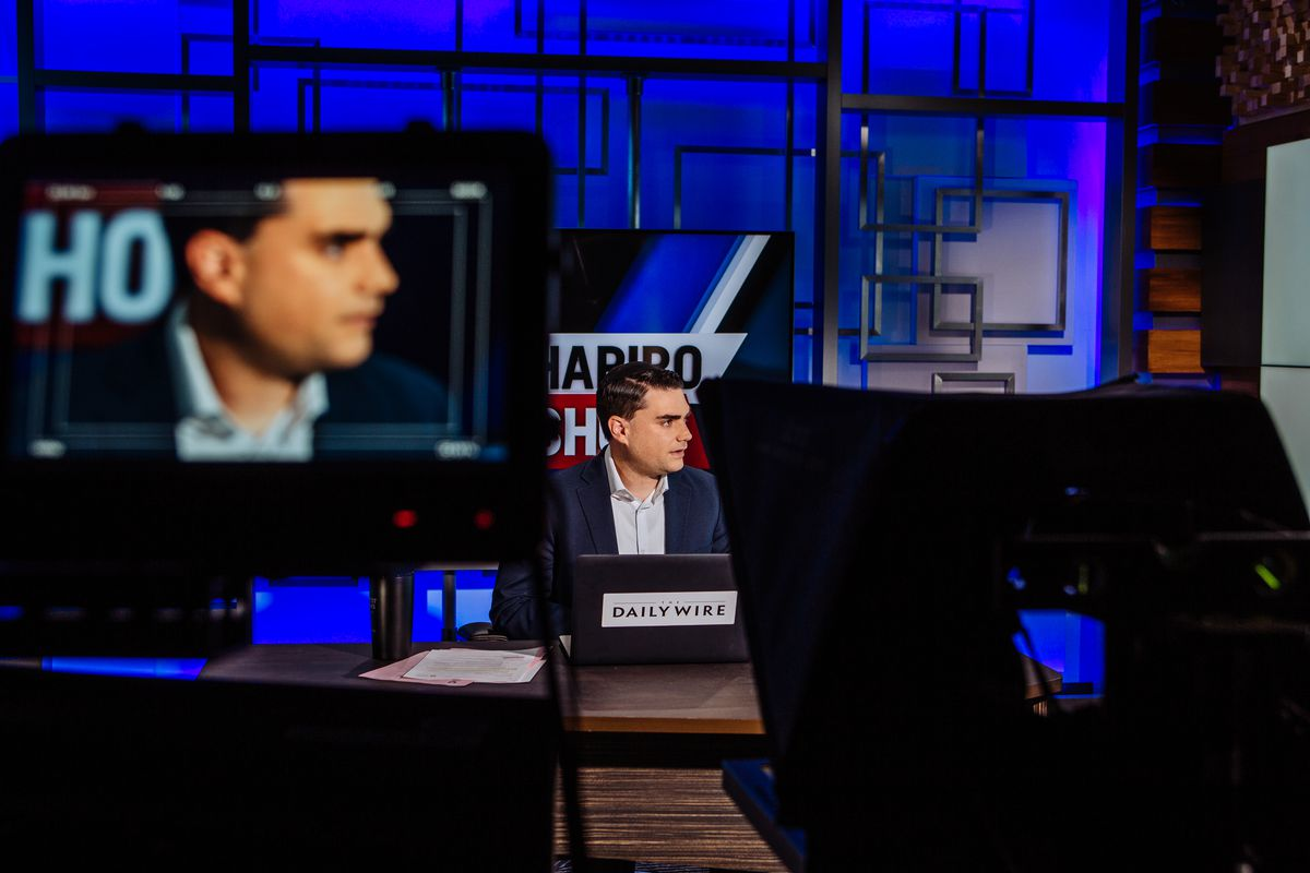 Ben Shapiro, the conservative personality who runs the Daily Wire, sits in a studio.
