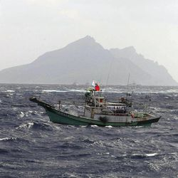 In this photo released by Taiwan's Central News Agency, a Taiwanese fishing boat comes close to the disputed islands called Senkaku in Japan and Diaoyu in China, in the East China Sea, Tuesday, Sept. 25, 2012. On Tuesday morning, about 50 Taiwanese fishing boats accompanied by 10 Taiwanese surveillance ships came within almost 20 kilometers (about 12 miles) of the disputed islands- within what Japan considers to be its territorial waters.