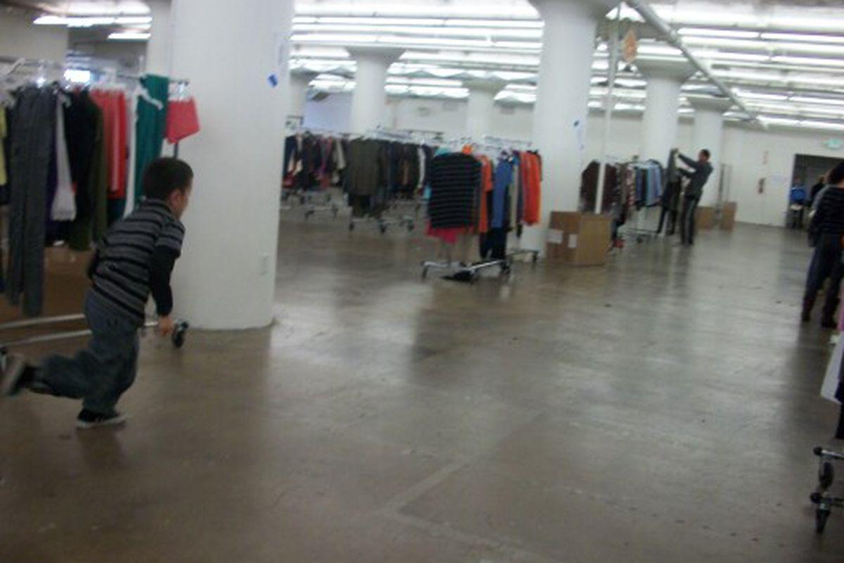 A little boy runs through the massive Ella Moss/Splendid warehouse sale on Saturday