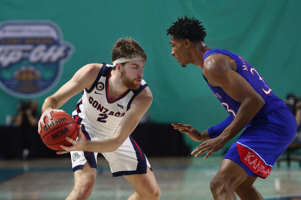 Gonzaga Bulldogs forward Drew Timme drives to the basket as Kansas Jayhawks forward David McCormack defends during the first half at Suncoast Credit Union Arena.