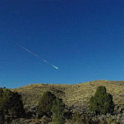 This image provided by NASA's Jet Propulsion Laboratory shows a meteor over Reno Nevada Sunday April 22, 2012. The former space rock-turned-flaming-meteor entered Earth's atmosphere around 8 a.m. PDT. Reports of the fireball have come in from as far north as Sacramento, Calif. and as far east as North Las Vegas, Nev. Bill Cooke of the Meteoroid Environments Office at NASA's Marshall Space Flight Center in Huntsville, Ala., estimates the object was about the size of a minivan, weighed in at around 154,300 pounds (70 metric tons) and at the time of disintegration released energy equivalent to a 5-kiloton explosion.