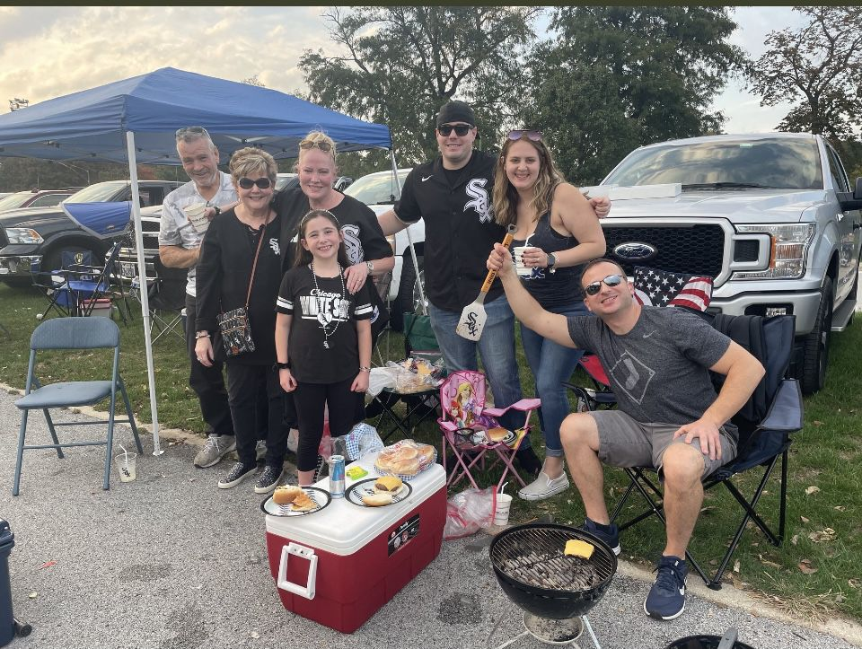 Sally Bucciarelli (third to the left) with her family and friends pre-game party in a parking lot outside Guaranteed Rate Field.