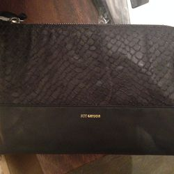 Oversize pouch in black, $49 (was $175)
