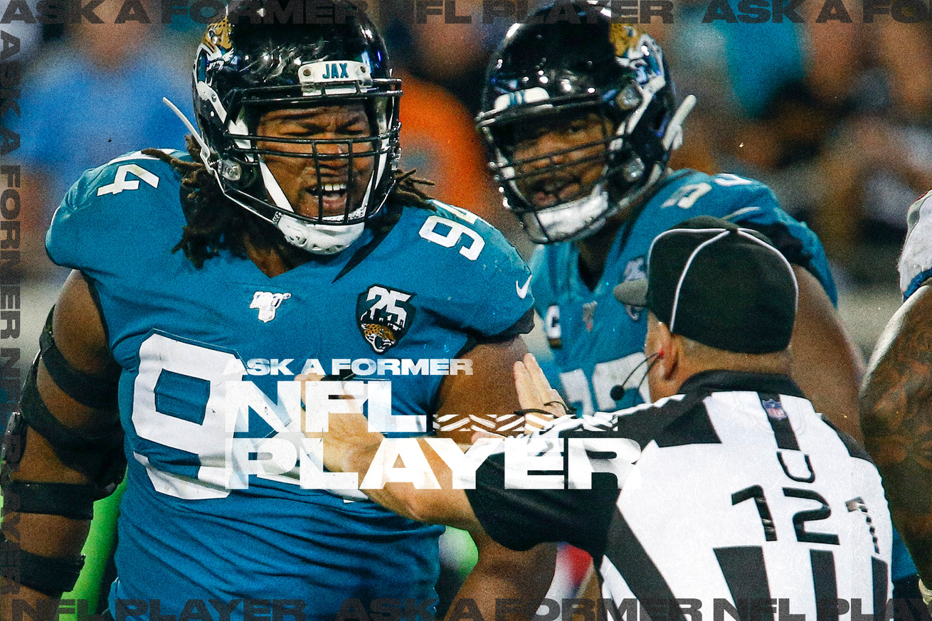 NFL ref holds up hands to Jaguars DE Dawuane Smoot, with Calais Campbell in the background