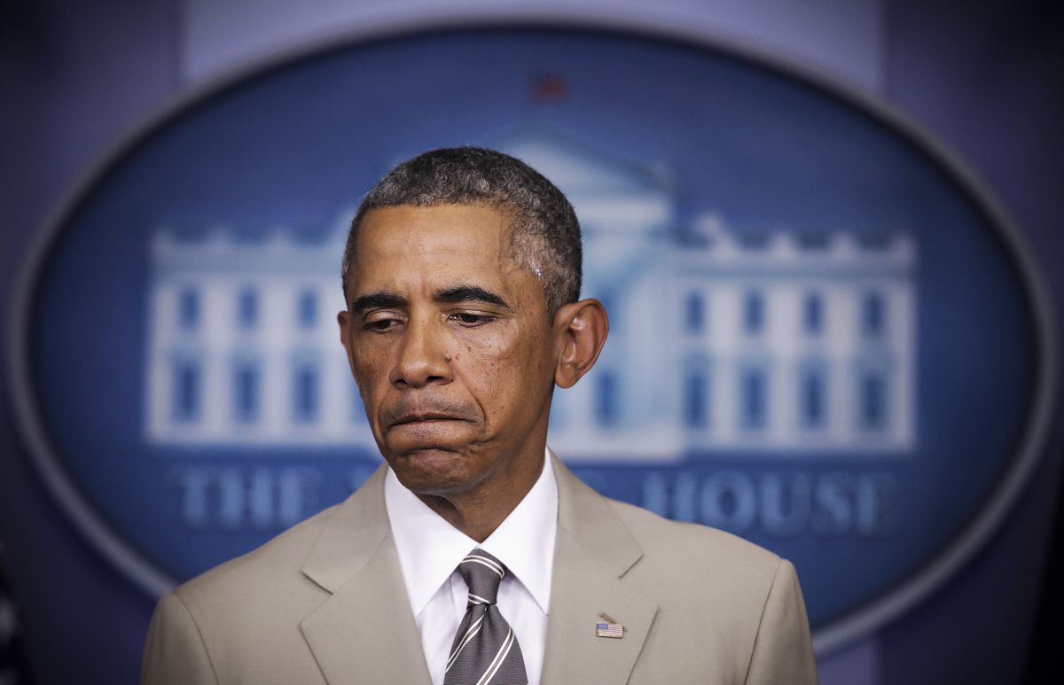 President Barack Obama speaks with the press regarding ISIL and immigration reform on August 28, 2014