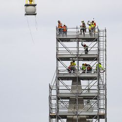 The Angel Moroni statue is temporarily removed by crane from atop the Salt Lake Temple of The Church of Jesus Christ of Latter-day Saintsin Salt Lake City on Monday, May 18, 2020.