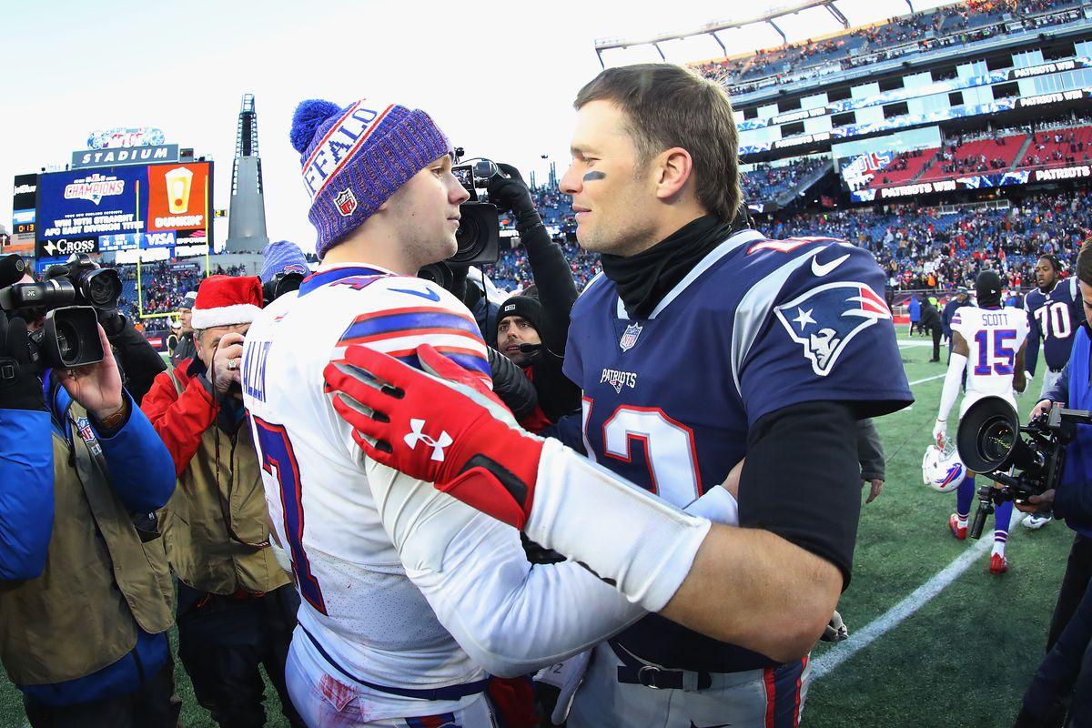 Josh Allen #17 of the Buffalo Bills and Tom Brady #12 of the New England Patriots meet on the field after the New England Patriots defeated the Buffalo Bills 24-12 at Gillette Stadium on December 23, 2018 in Foxborough, Massachusetts.
