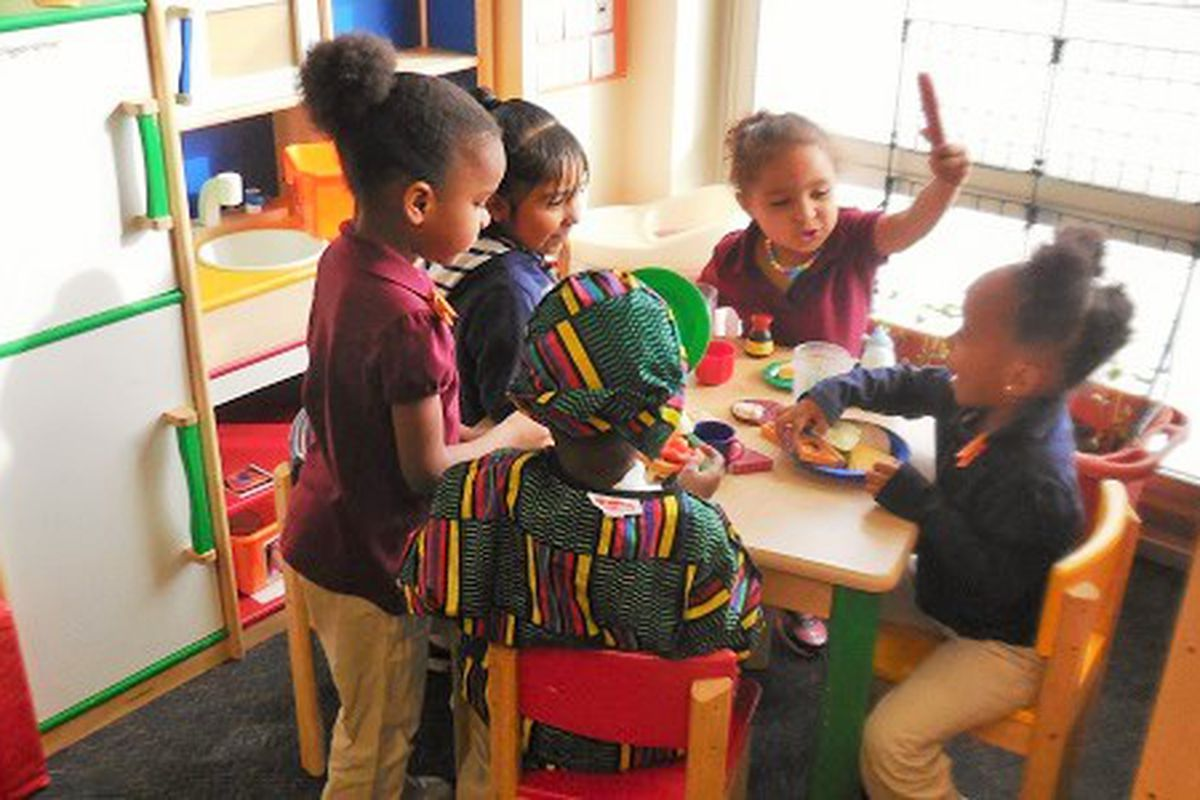 Preschoolers at McGlone play together in the kitchen center.