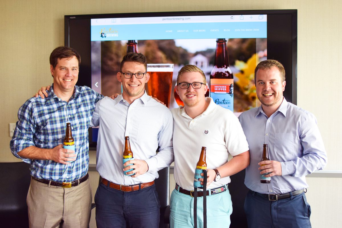 From left, Pontoon Brewing's Marcus Powers (second from left) and Sean O'Keefe (second from right) with CBRE real estate brokers Chris Irby (left) and Wesley Budd (right).