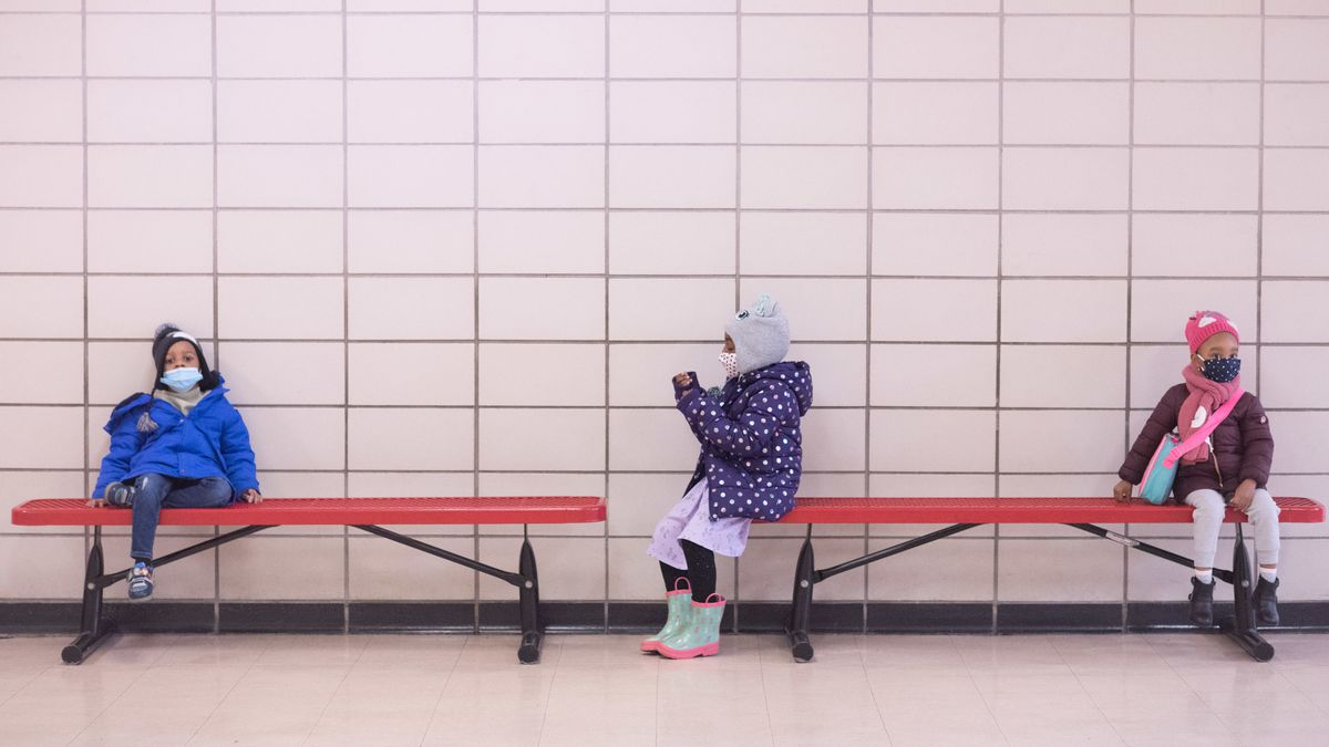 Preschool students sit on benches at Phyl's Academy in Brooklyn in March 2021. Michael Appleton/Mayoral Photography Office