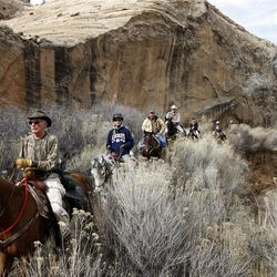 Riding along the sandstone walls in the Little Grand Canyon of the San Rafael Swell  Saturday, April 2, 2011, in the San Rafael Swell in Central Utah.