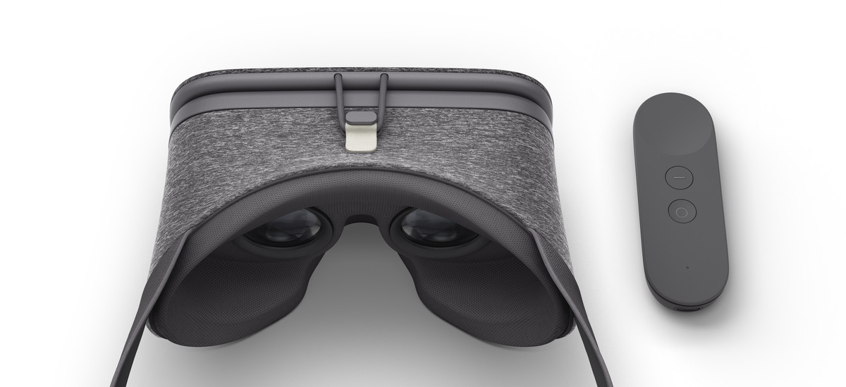 A virtual reality headset that looks sort of like steampunk googles if they were redesigned by Timbuk2. They are grey, everything looks sort of molded and soft, and they seem to be covered in a cozy neoprene sweater. The phone attaches at the front with a