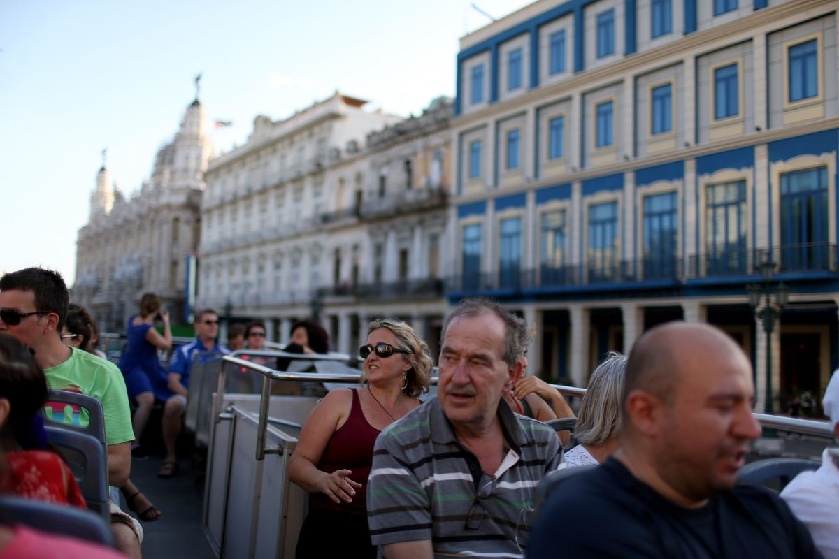 Tourists take in the sites from a double-decker tour bus of Havana a day after the second round of diplomatic talks between the United States and Cuban officials took place in Washington, DC, on February 28, 2015, in Havana, Cuba.