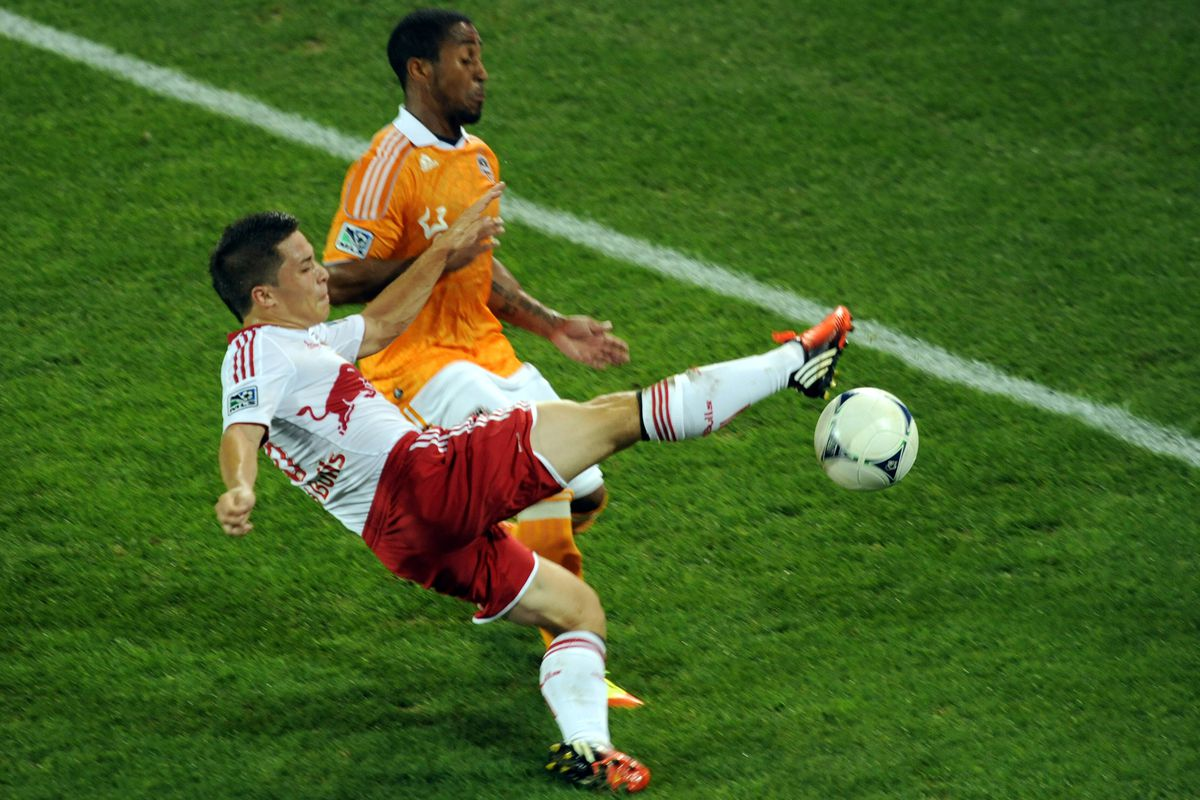 Aug 10, 2012; Harrison, NJ, USA;  New York Red Bulls defender Connor Lade (16) defends against Houston Dynamo defender Corey Ashe (26) during the first half at  Red Bull Arena. Mandatory Credit: Joe Camporeale-US PRESSWIRE
