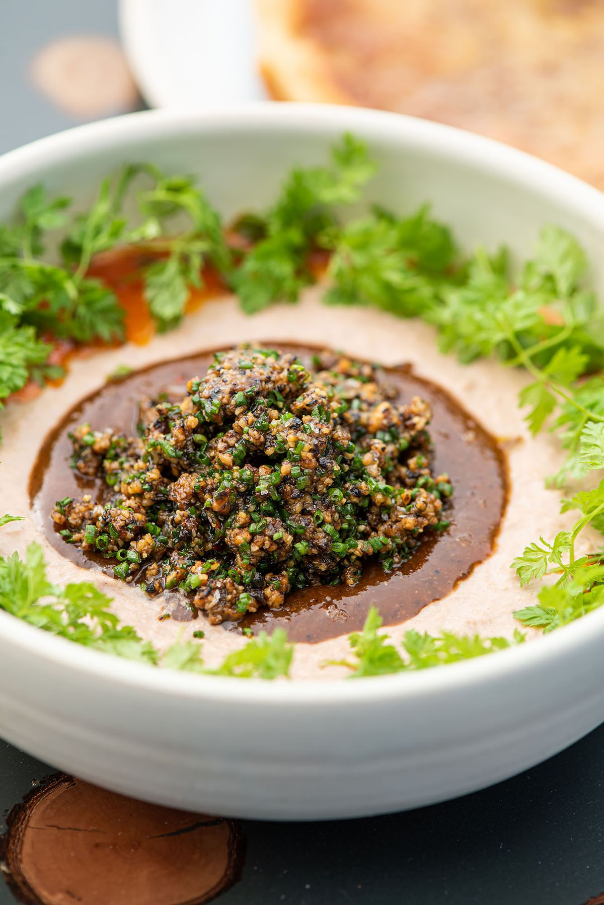 Whipped eggplant spread in a white bowl.