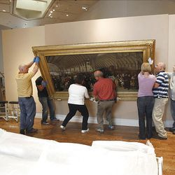 Employees at BYU's Museum of Art get ready for a new art exhibit on Victorian art.  They are hanging part of the Thomas Holloway collection.