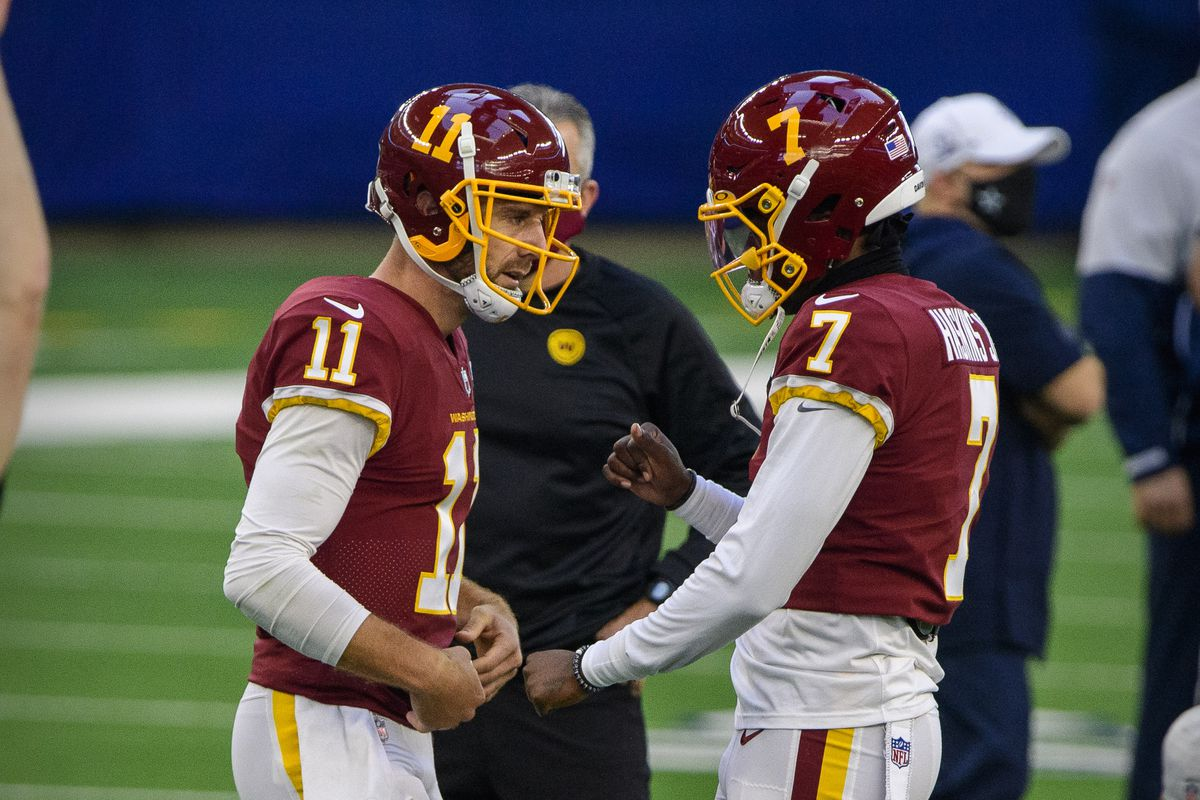 Washington Football Team quarterback Dwayne Haskins (7) and quarterback Alex Smith (11) warms up before the game against the Dallas Cowboys at AT&T Stadium.