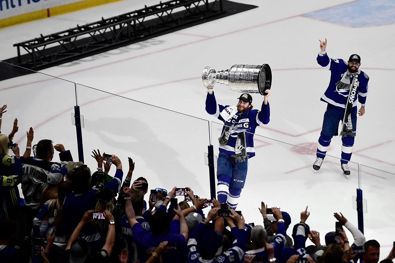 Jul 7, 2021; Tampa, Florida, USA; Tampa Bay Lightning center Brayden Point (21) hoists the Stanley Cup after the Lightning defeated the Montreal Canadiens 1-0 in Game 5 to win the 2021 Stanley Cup Final at Amalie Arena.
