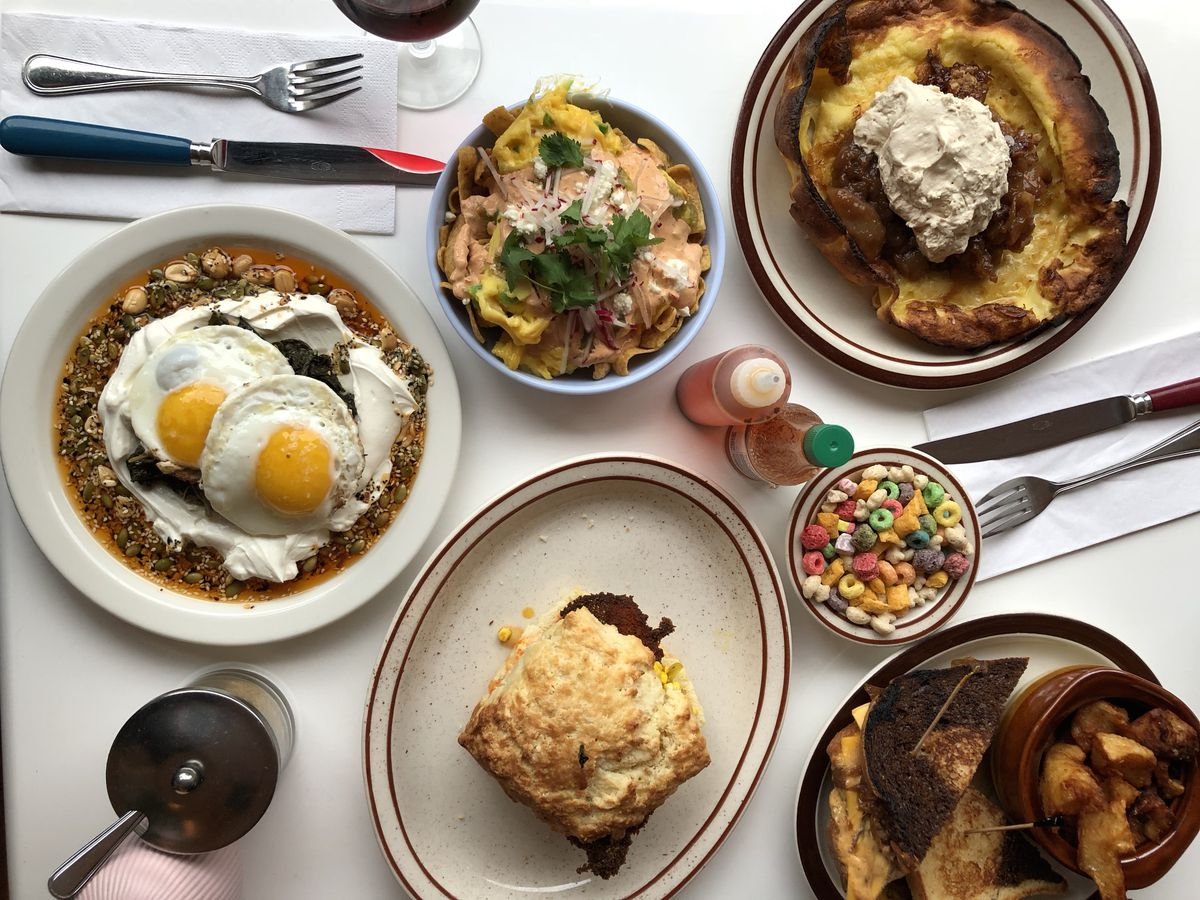 A spread at Meme's Diner, including sunny-side up eggs, cereal, and a biscuit.