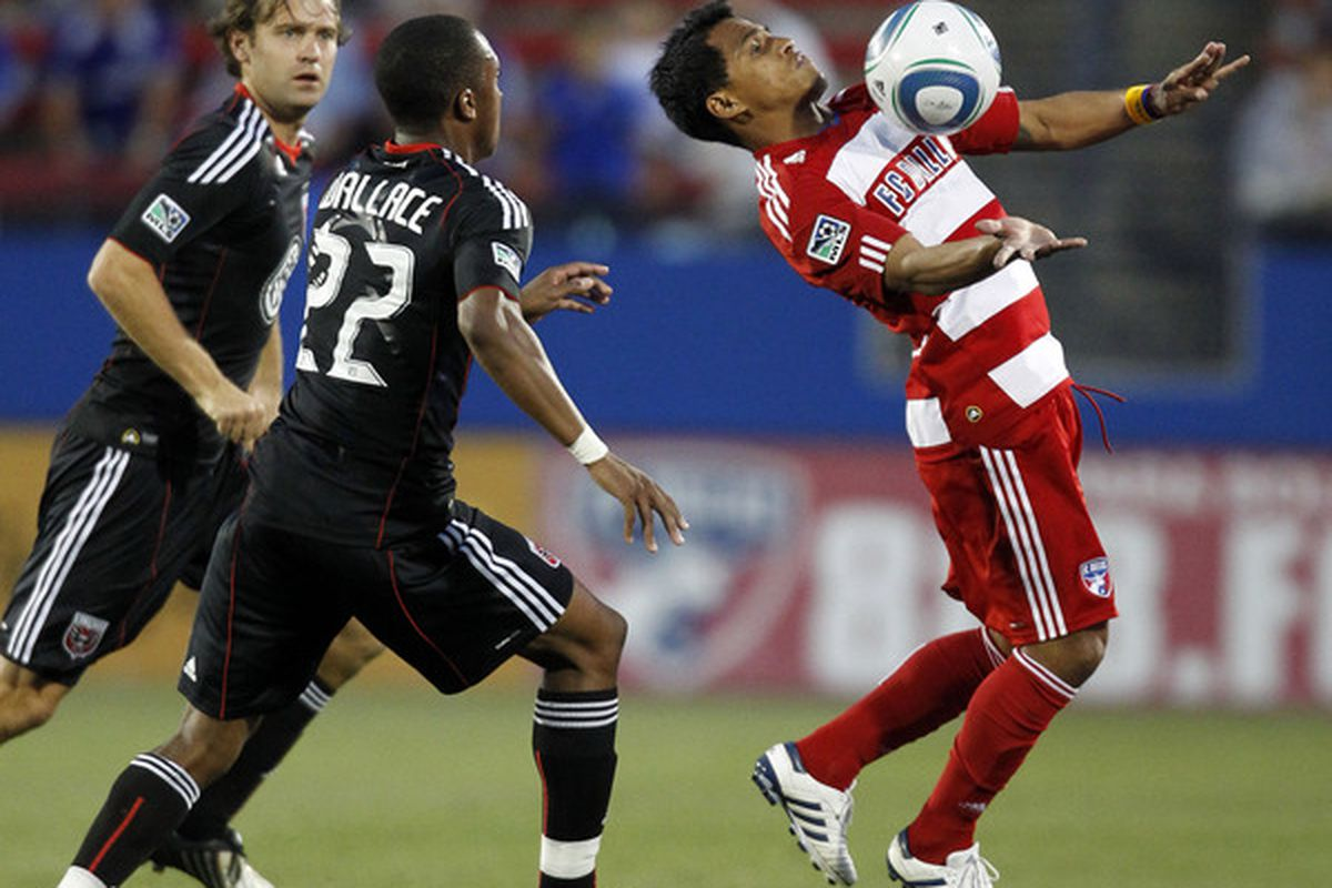 FRISCO, TX - MAY 8: David Ferreira #10 of FC Dallas controls the ball against Rodney Wallace #22 of D.C. United at Pizza Hut Park on May 8, 2010 in Frisco, Texas. (Photo by Layne Murdoch/Getty Images)