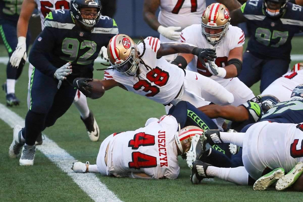 JaMycal Hasty #38 of the San Francisco 49ers scores a touchdown against Bryan Mone #92 of the Seattle Seahawks in the second quarter of the game at CenturyLink Field on November 01, 2020 in Seattle, Washington.