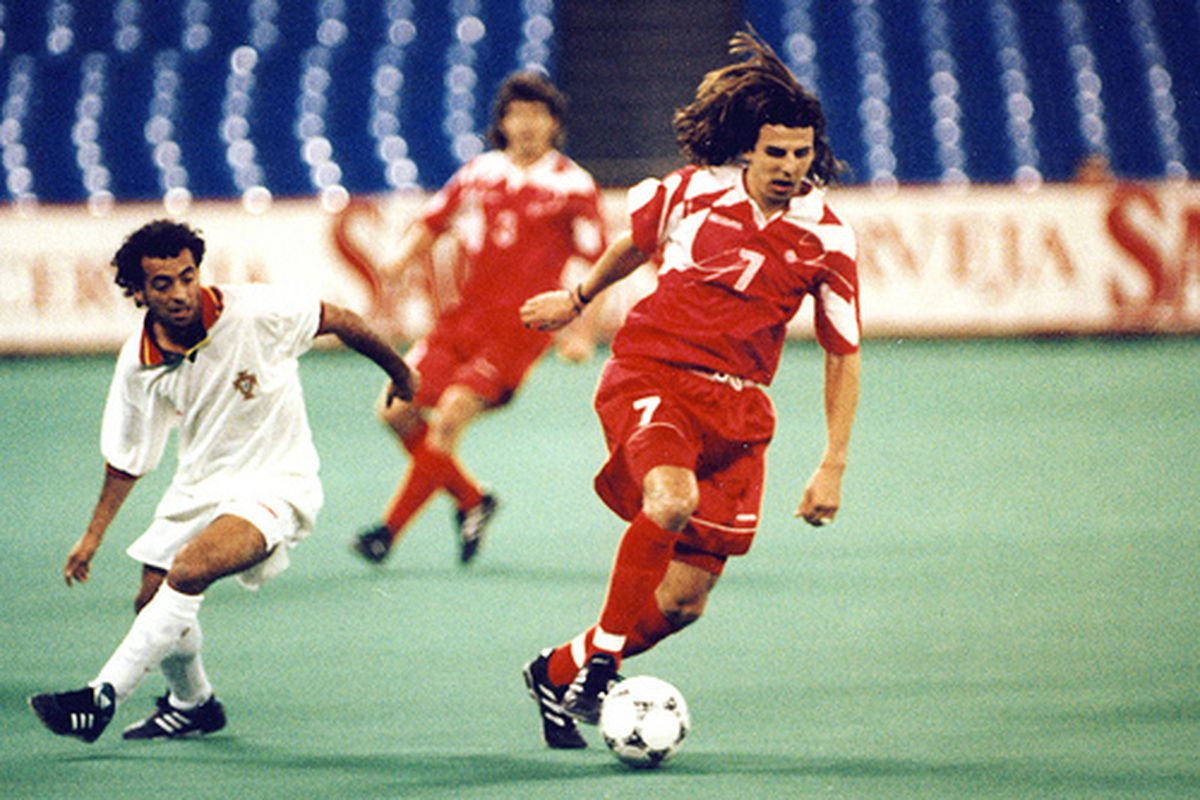 No photos of Canada-Denmark at the SkyDome Cup but check out Nick Dasovic's hair in action against Portugal!