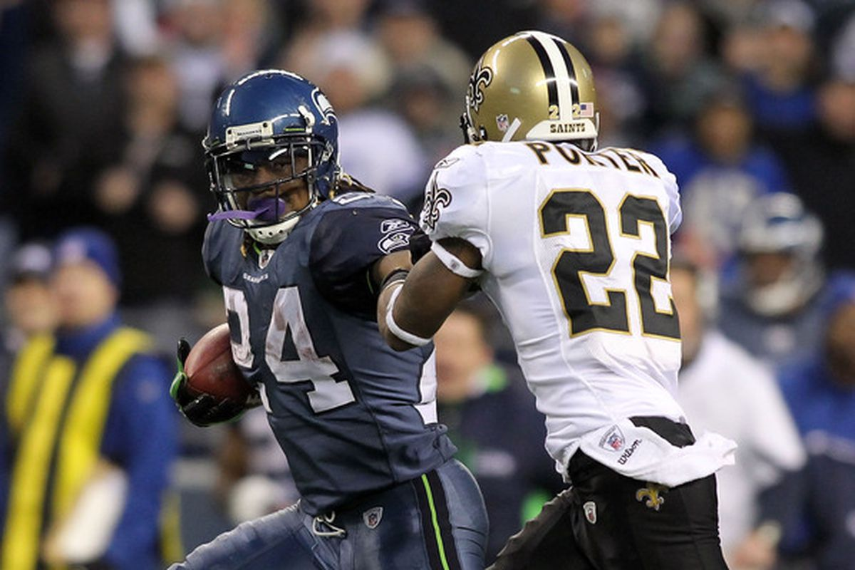 Marshawn Lynch (left) stiff arms Tracy Porter (right) in his run that beat the Saints and caused an earthquake.