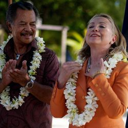 U.S. Secretary of State Hillary Rodham Clinton adjusts her black pearl necklace, a gift from Cook Island Prime Minister Henry Puna, left, during an event on sustainable development and conservation, in Rarotonga, Cook Islands, Friday, Aug. 31, 2012.